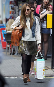 Fearne paired her carmel shoulder bag with a jean vest and a metallic skirt.