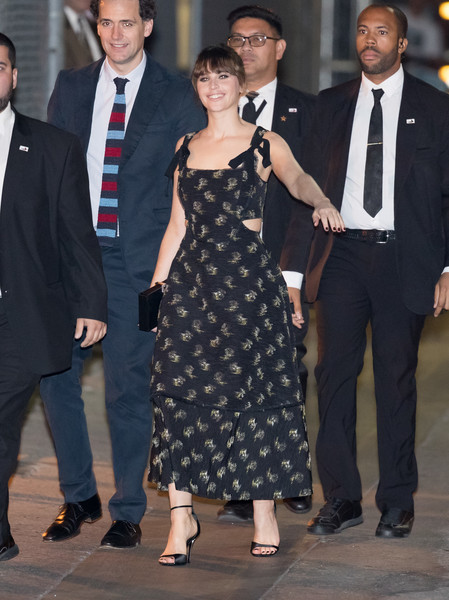 Felicity Jones finished off her outfit with black ankle-strap satin sandals.