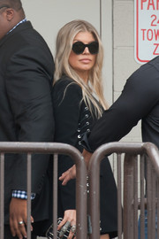 Fergie accessorized with funky round shades while out at the Grove.