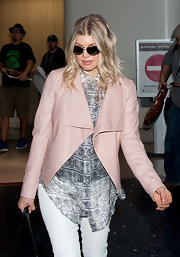 Fergie kept things feminine at the airport in a pink leather shawl front jacket.