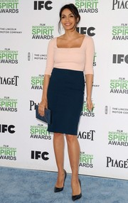 Rosario Dawson accessorized her dress with an elegant blue envelope clutch by Smythson.
