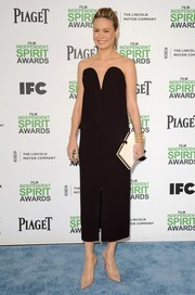 Brie Larson finished off her sophisticated ensemble with a white Smythson Soho Diary clutch.