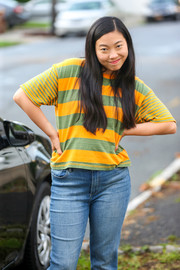 Awkwafina was spotted on the set of 'Awkwafina is Nora from Queens' wearing a yellow and green striped tee.