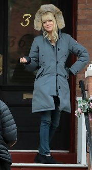 Emma Stone kept warm on the set of 'The Amazing Spider-Man 2' with this blue coat with a fur-trimmed hood.