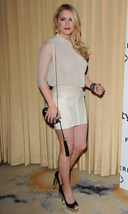 Leven Rambin added drama to her short ivory number with a tasseled metal purse.