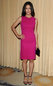 Julia Jones maintained her minimalist style, accenting her fuchsia shift with a sleek black clutch.