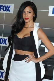 The sexy pop star donned a sultry black and white ensemble for the Fox All-Star party. She finished off the look with a bright red pout and a bold cocktail ring.
