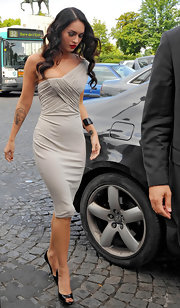 Megan Fox wore a dove gray one-shoulder cocktail dress to the 2009 Armani Fashion Show.