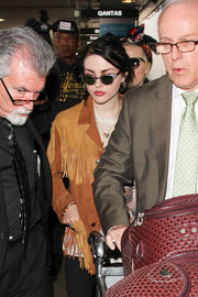Frances Bean Cobain hid her eyes behind a pair of cateye sunnies as she made her way through LAX.