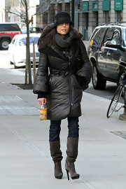 Bethenny Frankel went for a walk in NYC wearing a pair of heeled gray suede boots.