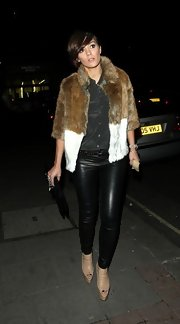 Frankie Sandford showed her rocker edge with black leather pants while going out in London.