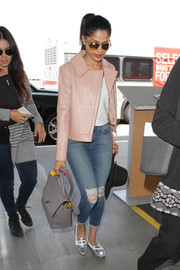 Freida Pinto caught a flight at LAX looking stylish in a boxy pink leather jacket.