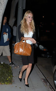 This studded bag breaks up the  monotonous color pallet in Kate's outfit and gives it a subtle edge.