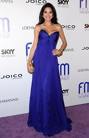 Joyce Giraud chose a flowing purple strapless gown with a beaded trim on the bodice for her look at the Friend Movement Benefit Concert.