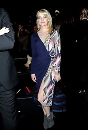 Emma Stone paired her printed wrap dress with gray suede ankle boots.