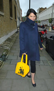 Sadie Frost braved the cold in a stylish navy blue trenchcoat outside the Young Zulu Warriors Concert.