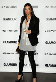 Demi Moore matches her blazer and sheer blouse to skinny black leather pants.
