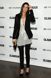 Demi wears a long striped sheer blouse under a blazer.  The low plunging tie neck make this piece extra showy.