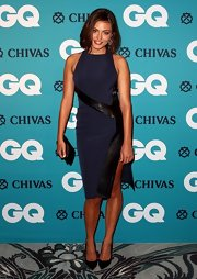 Phoebe Tonkin smiled for the camera in a navy dress with leather trim at the GQ Men of the Year Awards.