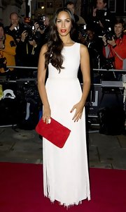 Leona Lewis was ultra chic on the red carpet in a white evening dress, complete with a fringe skirt. She opted for a red clutch and a bright red pout for pop of color.