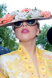 Lady Gaga wore a bright pink lipstick to match her floral ensemble.