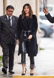 Gemma Chan sealed off her all-black look with a pair of Louboutin stilettos.