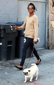 Genevieve Jones walked around Soho in modern round sunglasses.