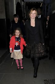 Geri Halliwell added a cool masculine touch to her frilly skirt with this tailored black blazer.