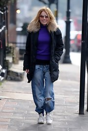 Geri Halliwell said goodbye to her typical spicy look and hello to these rough-and-tumble ripped jeans.