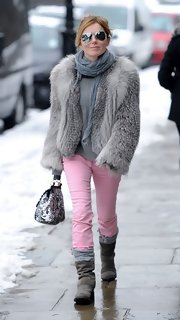 Geri Halliwell loves glamorous pieces, just like this fur coat, which she wore on a casual stroll with her daughter.