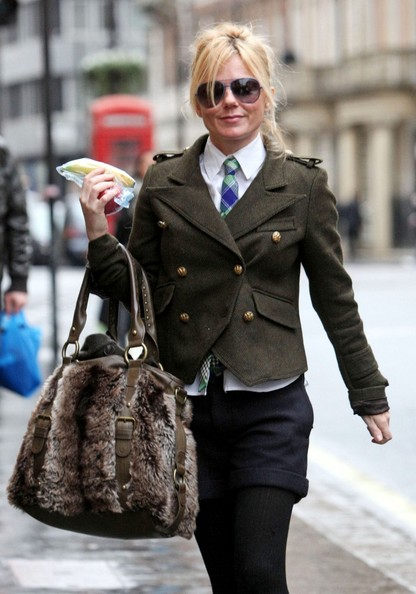 You know a girl's got style when she rocks a plaid tie with a military jacket.
