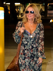 Geri Halliwell paired her Bohemian outfit with classic Ray-Ban aviators and a smile.