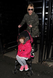 Geri wears a camo winter jacket for taking her baby on a stroll.