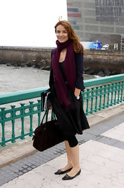 Saffron Burrows channeled a vintage vibe with her pointy black flats.