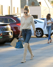 Gigi Hadid was street-chic in a cream colored lace-up sweater by Red Valentino while out and about.