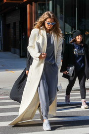 White Reebok leather sneakers tied Gigi Hadid's look together.
