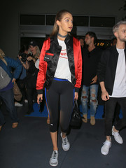Gigi Hadid teamed her jacket with a pair of Under Armour leggings and a white tee.