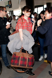 Ginnifer Goodwin matched her plaid button down to her red plaid tote with leather trim.