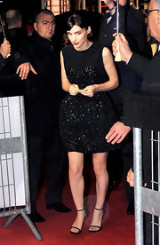 Burgeoning style star Rooney Mara accessorized her sparkly dress with delicate ankle strap heels.