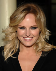 Malin Akerman styled her shoulder length locks into layered curls. Her two-toned color accented her tousled look.