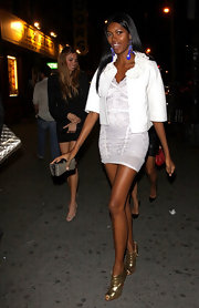 Jessica White strutted in gold peep toe ankle boots. The shoes definitely drew attention to Jessica's insanely long legs!