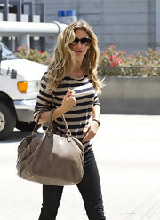 Gisele traveled in style at LAX with a striped tee paired with a taupe leather tote.