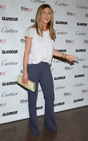 Jennifer Aniston accessorized her ensemble with a simple ivory frame clutch.