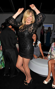 Penny Lancaster teamed up her LBD with floral evening pumps at the 'Glamour' party.