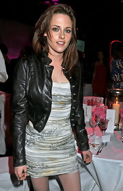 While attending the 2011 'Glamour' Women of the Year Awards, Kristen Stewart paired an edgy leather jacket with a form-fitting ruched dress.