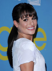 Lea Michele pulled her ultra-shiny hair back into a classic ponytail and wore her wispy bangs straight for a screening of 'Glee.'
