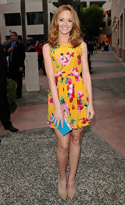 Jayma Mays added punch to her darling dress with this turquoise croco clutch.