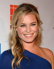 Rebecca Romijn highlighted her glowing complexion with a tousled half up hairstyle.