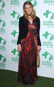 Angela Lindvall paired her flowing maxi dress with a fitted black blazer to give her look more of a dressy feel.