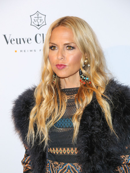 Rachel Zoe stuck to her signature boho waves when she attended the opening of What Goes Around Comes Around.